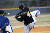 A batter about to hit a pitch during a baseball game. — Stock Photo