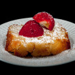 Pound cake with strawberry on black — Stock Photo
