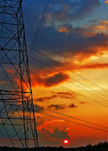 Electric grid network power high voltage transmission lines pylo — Stock Photo
