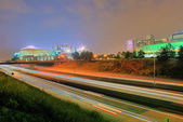 Charlotte skyline at night with highway traffic — Stock Photo