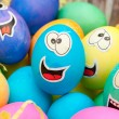 Smiley easter eggs in a holiday basket arrangement — Stock Photo