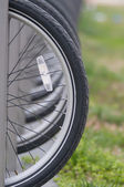 Tires with reflector of parked bikes in a city — Stock Photo