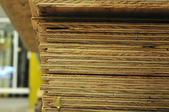 Edge of stack of plywood — Stockfoto
