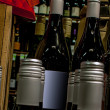 Wine bottles on display at store — Stock Photo