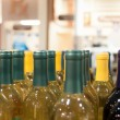 Wine bottles shot with limited depth of field on display in a li — Stock Photo