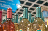 Wine bottles shot with limited depth of field on display in a li — Stock Photo #24415127