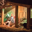 Live Christmas nativity scene reenacted in a medieval barn — Stock Photo