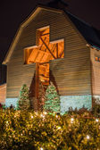 Architectural cross at a village decorated for christmas time — Stock Photo