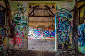 Abandoned building walls full of graffiti — Stock Photo