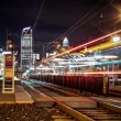 Charlotte City Skyline night scene with light rail system lynx t - Stock Photo