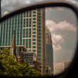 Stock Photo: Buildings seen in side mirror