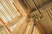 Exposed underside of steel floor or roof deck with utilities and — Stock Photo