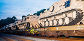 Usa military tanks on train cars — Stock Photo