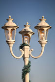 Beautiful classic street lamp post by the street — Stock Photo