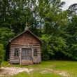 Stock Photo: Old wood log cabin church in forest