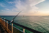 Fishing of an ocean pier — Stock Photo