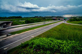 Clover leaf exit ramps on highway near city — Stock Photo