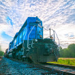 Stock Photo: Blue freight train engine at sunrise