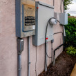 Stock Photo: Electric service panels on building