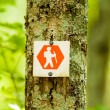 Orange hiking trail sign — Stock Photo
