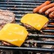������, ������: Hamburgers with cheese and hot dogs on grille