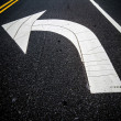 Painted direction arrow on pavement — Stock Photo