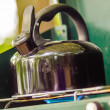 Teapot on stove at camp — Stock Photo