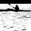 Stock Photo: Sillouette of man kayaking on lake