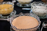 Various salad dressings in crystal bowls — Stock Photo