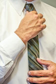 Man fixing a tie with hands — Stock Photo