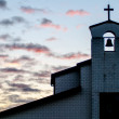 Classic church silhouette on tropical sunset — Stock Photo #33725167