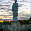 Religious statue silhouette at sunset — Stock Photo