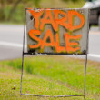 Orange handwriting yard sale sign — Stock Photo