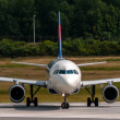 Airplane front close-up view airfield ground day time — Stock Photo