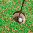 Golf ball on green, in front of hole, — Stockfoto #33729209