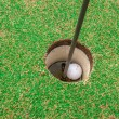Golf ball on green, in front of hole, — Stock fotografie #33729209