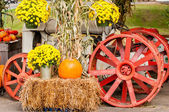 pumpkins next to an old farm tractor — Stock Photo