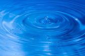 Blue multi colored water drop bubbling — Stock Photo