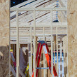 Wood frame construction job seen trhough window opening — Stock Photo