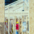 Wood frame construction job seen trhough window opening — Stockfoto