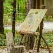 Easel in forest — Stock Photo