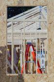 Wood frame construction job seen trhough window opening — Stock Photo