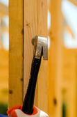 Worker hammering nails to wood studs — Stock Photo