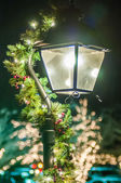 Street lights decorated for christmas — Stock Photo