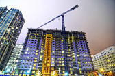 Tall highrise building under construction in a big city — Stock Photo