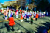 Abstract and defocused image of a thanksgiving parade in a big c — Stock Photo