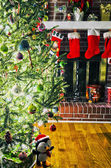 Lots os presents around christmas tree before christmas — Stock Photo