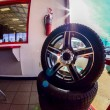 Stock Photo: Car tires on display for sale at tire shop store