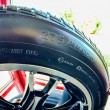 Стоковое фото: Car tires on display for sale at tire shop store