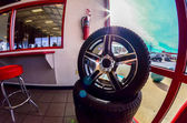Car tires on display for sale at a tire shop store — Stok fotoğraf